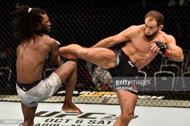 Mairbek Taisumov of Russia kicks Desmond Green in their lightweight bout during the UFC Fight Night event at Olimpiysky Arena on September 15 2018 in...