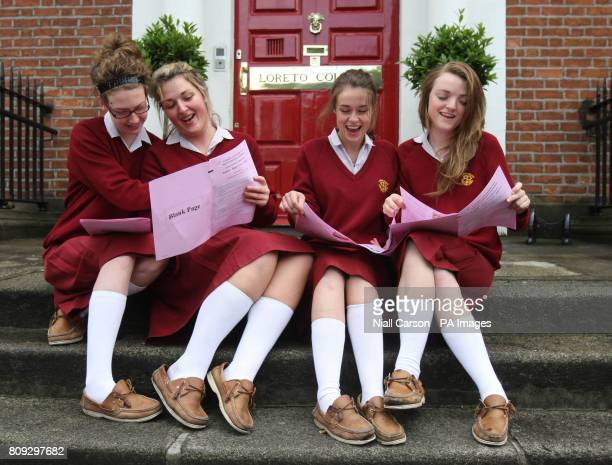 Mairead Conway, Lisa Clarke, Aideen Lambe and Hannah Dobson look over their English Leaving Certificate paper No.1 after taking the exam at Lorretto...