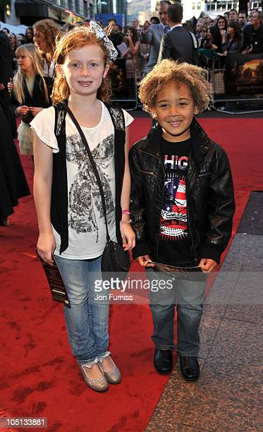 Maisie Smith and Devon Higgs attends the UK premiere of 'Legend Of The Guardians' at Odeon West End on October 10 2010 in London England