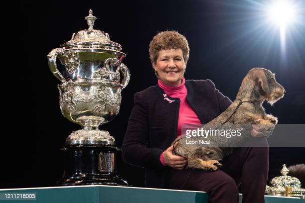 Maisie the Wire Haired Dachshund and owner Kim McCalmont from Gloucestershire pose after winning Best in Show on the last day of Crufts Dog Show at...