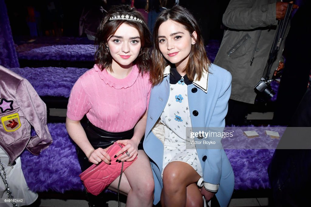 Maisie Williams and Jenna Coleman attend the Miu Miu show as part of the Paris Fashion Week Womenswear Fall/Winter 2017/2018 on March 7, 2017 in Paris, France.