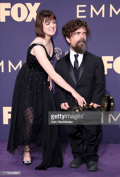 Maisie Williams and Peter Dinklage pose with award for Outstanding Drama Series in the press room during the 71st Emmy Awards at Microsoft Theater on...
