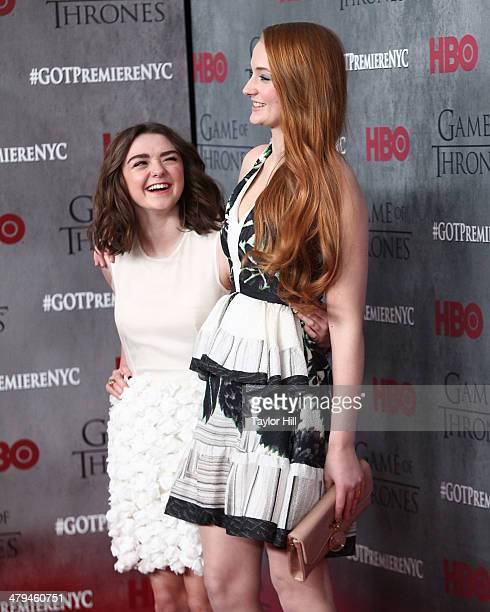 Maisie Williams and Sophie Turner attend the Game Of Thrones Season 4 premiere at Avery Fisher Hall Lincoln Center on March 18 2014 in New York City