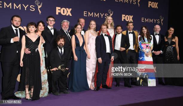 Maisie Williams, Isaac Hempstead Wright, Emilia Clarke, Peter Dinklage, Sophie Turner, Gwendoline Christie and cast pose with the Emmy for...