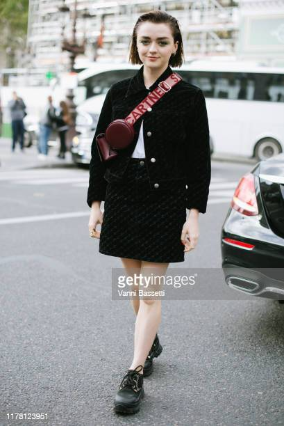 Maisie Williams poses wearing Stella McCartney before the Stella McCartney show at the Opera Garnier during Paris Fashion Week Womenswear Spring...