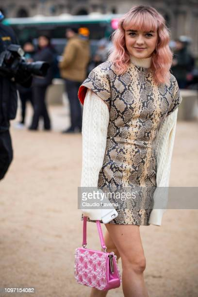 Maisie Williams wearing a white jumper and snake print mini dress is seen in the streets of Paris before the Kenzo show on January 20 2019 in Paris...