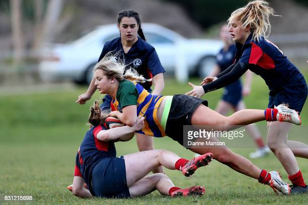 Maisie Young of Eastern Girls is tackled during the Southland Secondary School Girls Final match between Southland Girls High School v Eastern Girls...