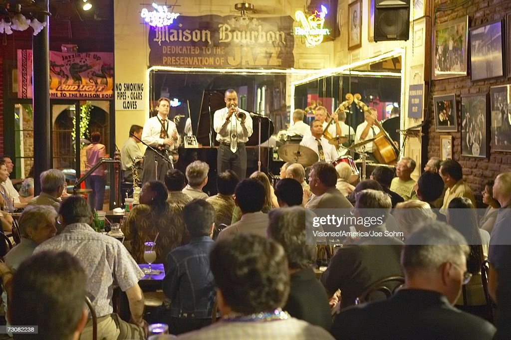 Maison Bourbon Jazz Club with Dixieland band and trumpet player performing at night in French Quarter in New Orleans, Louisiana : Stock Photo