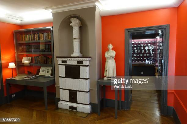 Maison de Balzac a house museum in the former residence of French novelist Honore de Balzac Pictured a collection of books masonry heater and a...