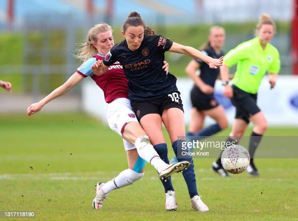 Maisy Barker of West Ham United tackles Caroline Weir of Manchester City during the Barclays FA Women's Super League match between West Ham United...