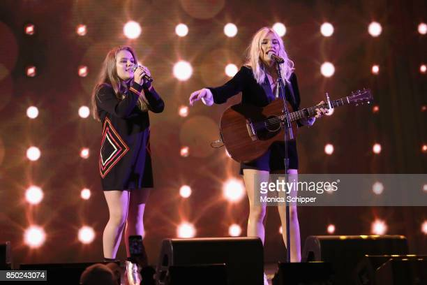 Maisy Jude Marion Stella and Lennon Ray Louise Stella of Lennon Maisy perform onstage at WE Day UN at The Theater at Madison Square Garden on...