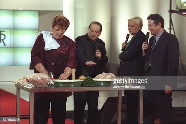 Maité makes her special stuffed duck recipe as P Timsit MRobin MDrucker look on