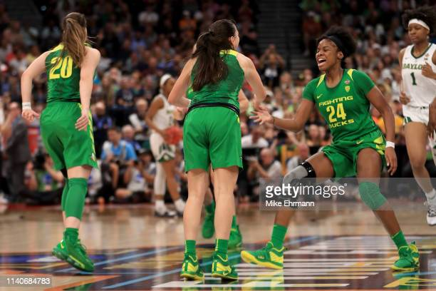 Maite Cazorla and Ruthy Hebard of the Oregon Ducks celebrate the play against the Baylor Lady Bears during the fourth quarter in the semifinals of...