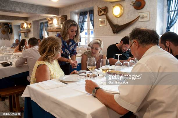 Maite coowner of the Restaurante Hermandad de Pescadores serves a table on July 24 2018 in Hondarribia Spain The restaurant became famous when in...