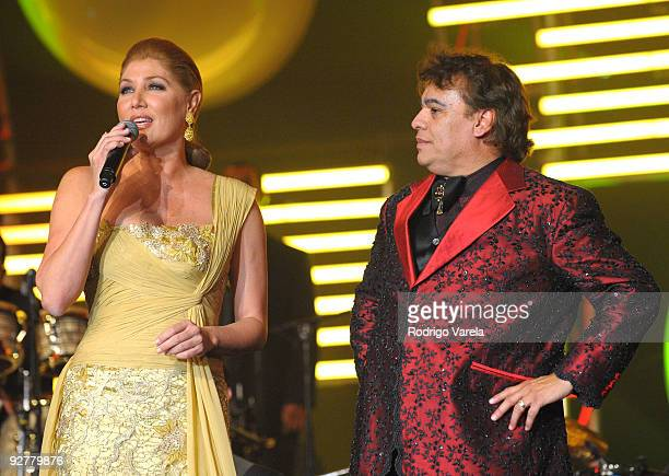 Maite Delgado and honoree Juan Gabriel speaks onstage at the 2009 Person Of The Year Honoring Juan Gabriel at Mandalay Bay Events Center on November...