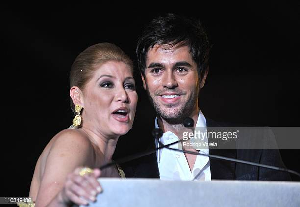 Maite Delgado and Singer Enrique Iglesias speak onstage at the 2009 Person Of The Year Honoring Juan Gabriel at Mandalay Bay Events Center on...