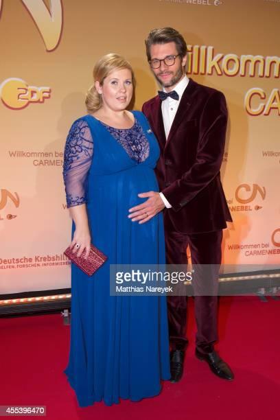 Maite Kelly and Florent Raimond attend the 'Willkommen bei Carmen Nebel' show at Velodrom on September 13, 2014 in Berlin, Germany.
