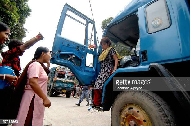 Maiti Nepal worker has a truck stopped that was carrying a suspect truck driver and a young girl on October 21 2005 in Kakarbhitta Nepal The Maiti...