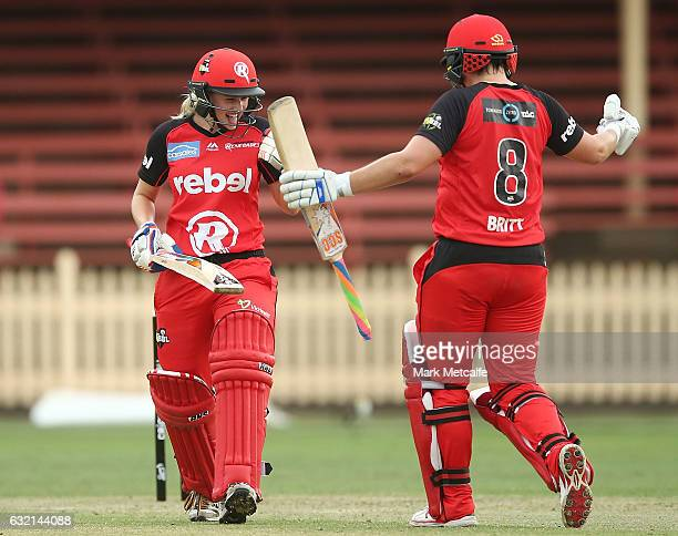 Maitlan Brown of the Renegades and Grace Harris of the Renegades celebrate victory after winning the Women's Big Bash League match between the...