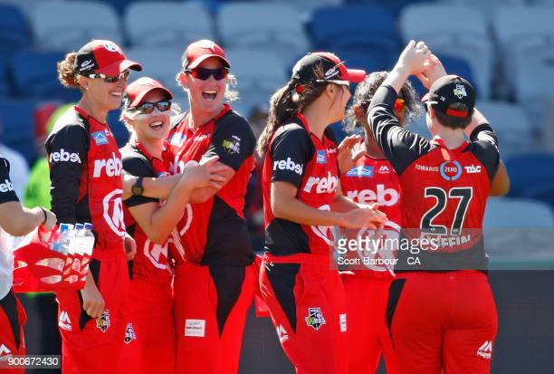 Maitlan Brown of the Renegades celebrates after her teammates after taking a catch to dismiss Ellyse Perry of the Sixers during the Women's Big Bash...