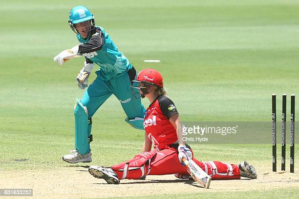 Maitlan Brown of the Renegades is stumped by Beth Mooney of the Heat during the Women's Big Bash League match between the Brisbane Heat and the...