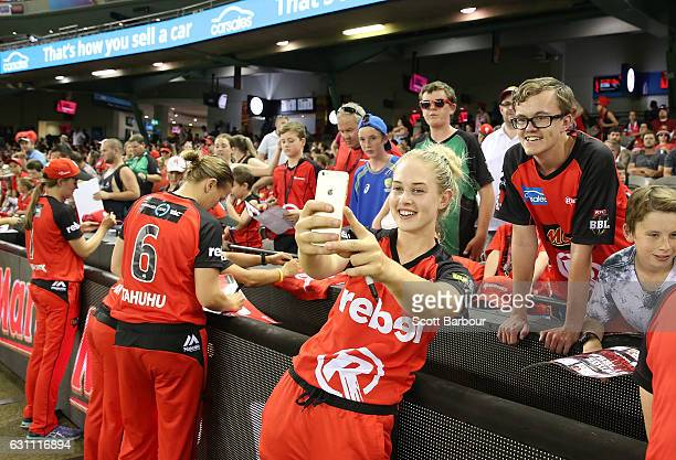 Maitlan Brown of the Renegades signs autographs for supporters in the crowd during the Women's Big Bash League match between the Melbourne Renegades...