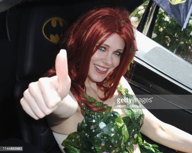 Maitland Ward dressed as Poison Ivy from 'Batman' poses with the1989 Batmobile from Tim Burton's 'Batman' film at Comic Con Revolution held at...