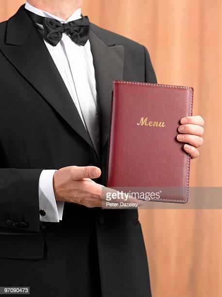 Maitre d' waiter presenting menu