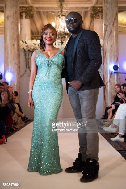 Maitre Gims and Producer/Designer Tiffany McCall Tiffany's Red Carpet Week Fashion Show at Carlton Hotel on May 23 2017 in Cannes France