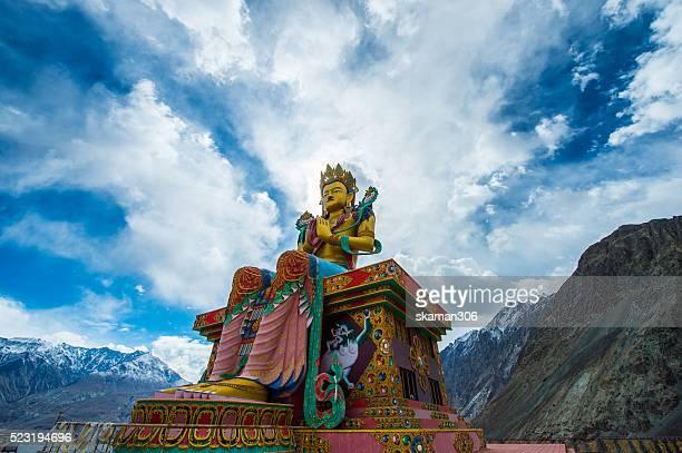 Maitreya buddha statue with Himalaya mountain at Diskit Monastery Nubra valley