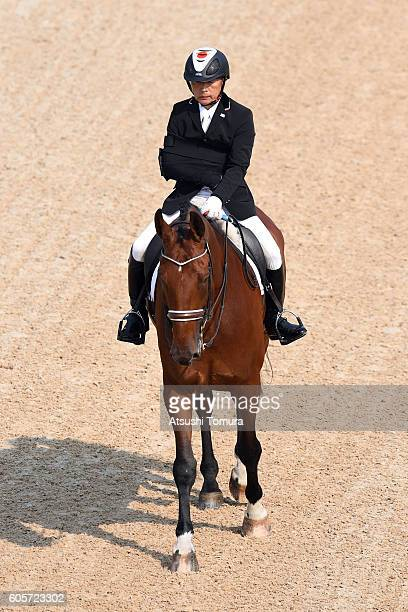 Maitsuhide Miyaji of Japan competes in the individual championship test grade 1b on day 7 of the Rio 2016 Paralympic Games at Olympic equestrian...