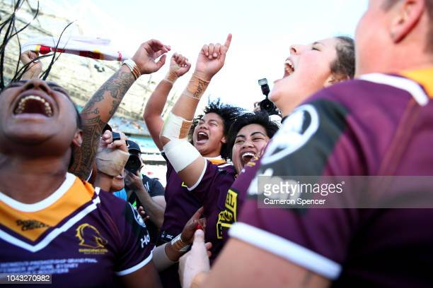 Maitua Feterika of the Broncos and team mates celebrate winning the 2018 NRL Women's Premiership Grand Final match between the Sydney Roosters and...