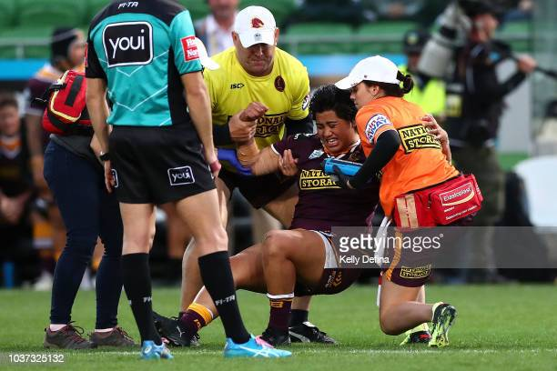 Maitua Feterika of the Broncos is assisted by medical trainers after a collision during the round three NRLW match between the Brisbane Broncos and...