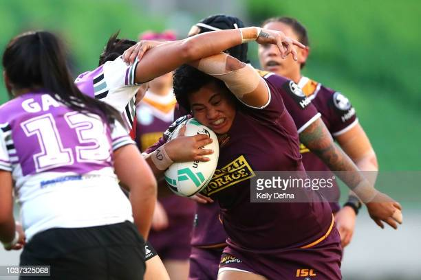 Maitua Feterika of the Broncos is tackled by Warriors defence during the round three NRLW match between the Brisbane Broncos and the New Zealand...