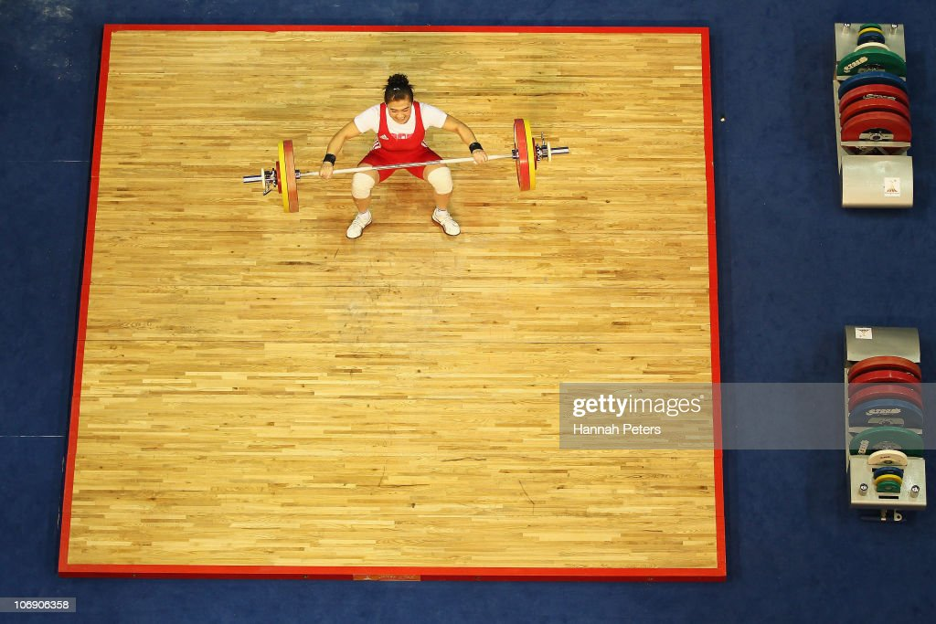 Maiya Maneza of Kazakhstan competes in the Women's Weightlifting 63kg competition during day four of the 16th Asian Games Guangzhou 2010 at Dongguan Gymnasium on November 16, 2010 in Guangzhou, China.