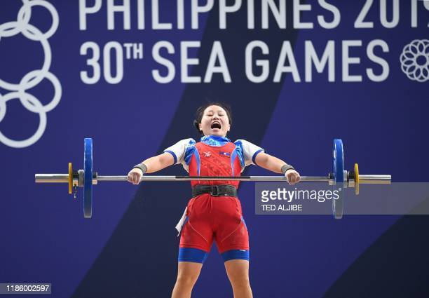 Maiyia Vue of Laos competes in the women's 55kg weightlifting snatch event at the SEA Games in Manila on December 2, 2019.