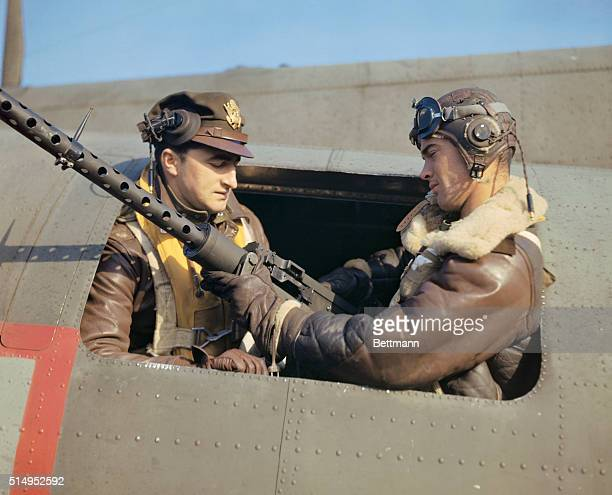 Maj Daniel F Riva of Hartford Conn fortress squadron commander talking with one of his waist gunners S/Sgt John Leahy of Norwood Mass who is...