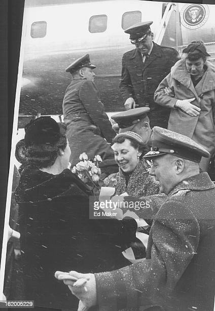 MAR 9 1958 MAR 10 1958 Maj Gen Eugene P Mussett Lowry Air Base commandant ushers his wife and Mrs Mamie Eisenhower together for presentation of a...