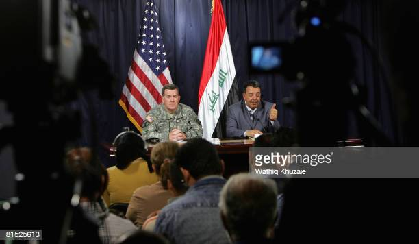 Maj Gen Kevin Bergner Spokesman for MultiNational Force Iraq and Dr Tahseen alSheikhly Civilian Spokesman for Operation Fardh alQanoon attend a press...