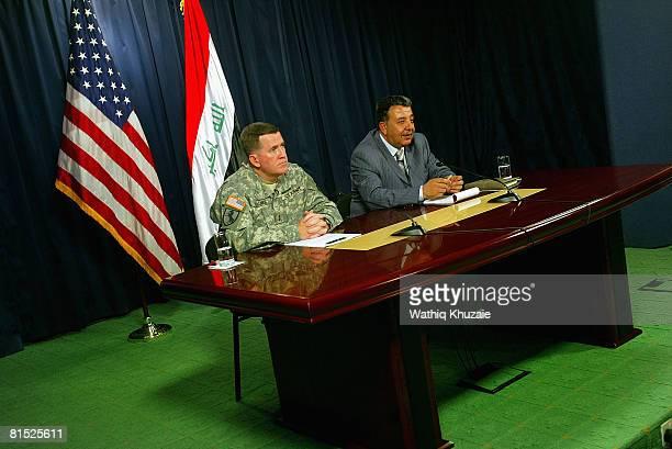 Maj Gen Kevin Bergner Spokesman for MultiNational Force Iraq and DrTahseen alSheikhly Civilian Spokesman for Operation Fardh alQanoon attend a press...
