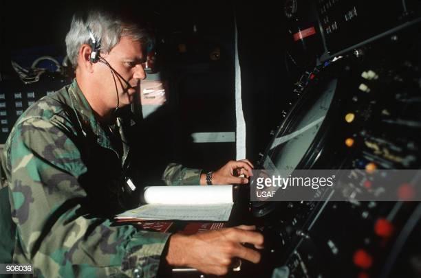 Maj John Patrick of the 129th Tactical Control Squadron Georgia Air National Guard monitors a radar screen in a TPS43 shelter during the NATO...