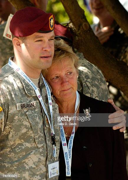 Maj Will Braman comforts Ann Hampton at memorial ceremony for fallen paratroopers with the 82nd Airborne Division at the Global War on Terrorism...