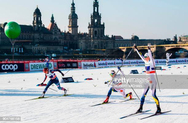 Maja Dahlqvist of second team Sweden celebrates as she crosses the finish line ahead of Stina Nilsson of first team Sweden and Sophie Caldwell of...