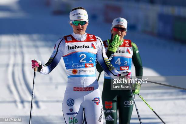 Maja Dahlqvist of Sweden and Sandra Ringwald of Germany look on after competing in the first semifinal run for the Ladies' Cross Country Team Sprint...
