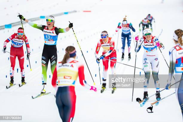 Maja Dahlqvist of Sweden beats Anamarija Lampic of Slovenia and Maiken Caspersen Falla of Norway to the finish line winning first place in the Cross...