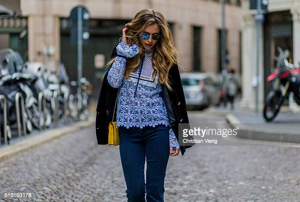 Maja Malnar wearing a babyblue blouse by Mrself portrait navy jeans from Mother denim Bulgari bag Zara studio jacket Taylor Morris sunglasses seen...