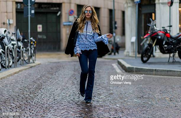 Maja Malnar wearing a babyblue blouse by Mrself portrait navy jeans from Mother denim Bulgari bag Lanvin shoes Zara studio jacket Taylor Morris...