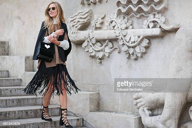 Maja Malnar wearing an Isabel Marant sweater a Maje shirt a Les Petits Joueurs bag Zara shirt and shoes and Gentle Monster sunglasses after the John...