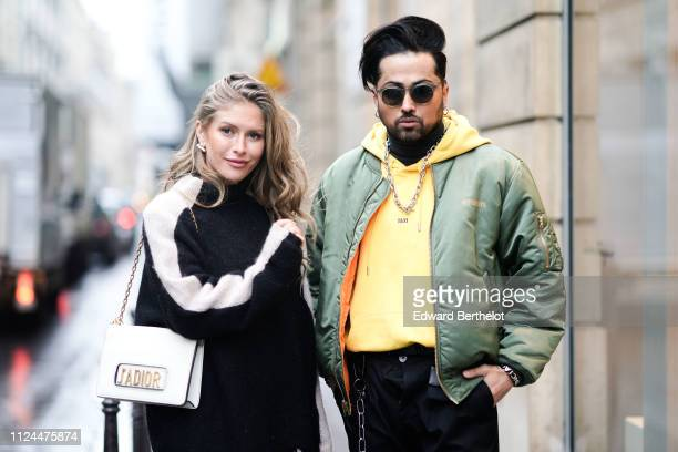 Maja Malnar wears a balck and white top and a Dior bag a Guest wears sunglasses a taxi yellow hoodie sweater a green bomber jacket from vetements...