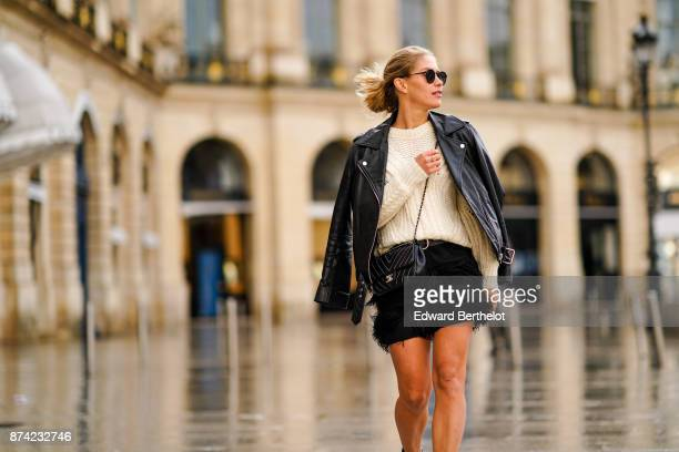 Maja Malnar wears Balenciaga silver boots a Milly black fringe skirt a Maje white wool sweater an Acne black leather pefecto jacket Taylor Morris...